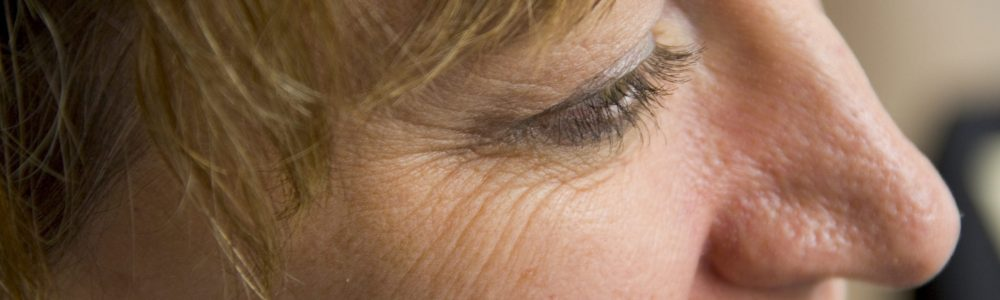 Close up portrait of woman smile lines at the edges of her eye